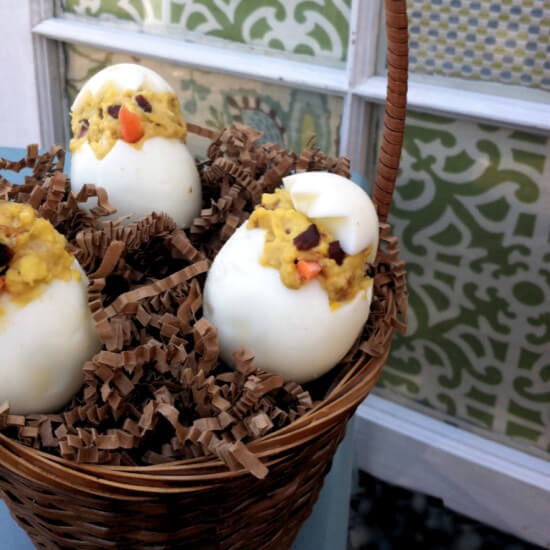 """Making these """"chicks"""" out of your deviled eggs is a fun project for kids!"""